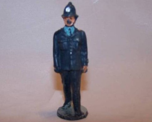 Toy Plastic London Bobby Police Officer in Mid-Stride