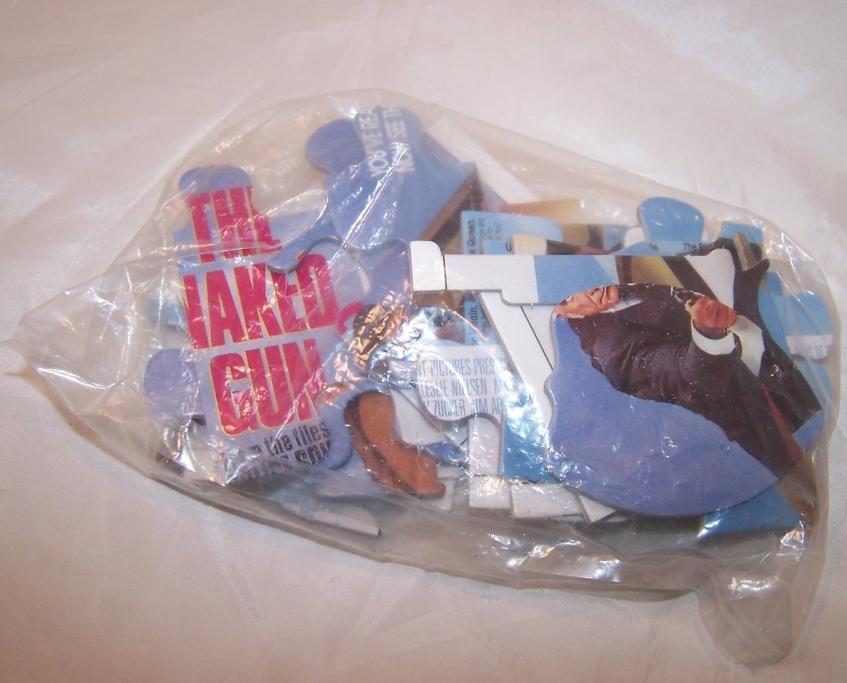 Image 2 of The Naked Gun Promotional Puzzle, Original Can, Bag Unopened
