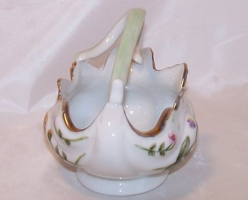 Image 1 of Flowing Floral Basket with Artistic Stylized Handle