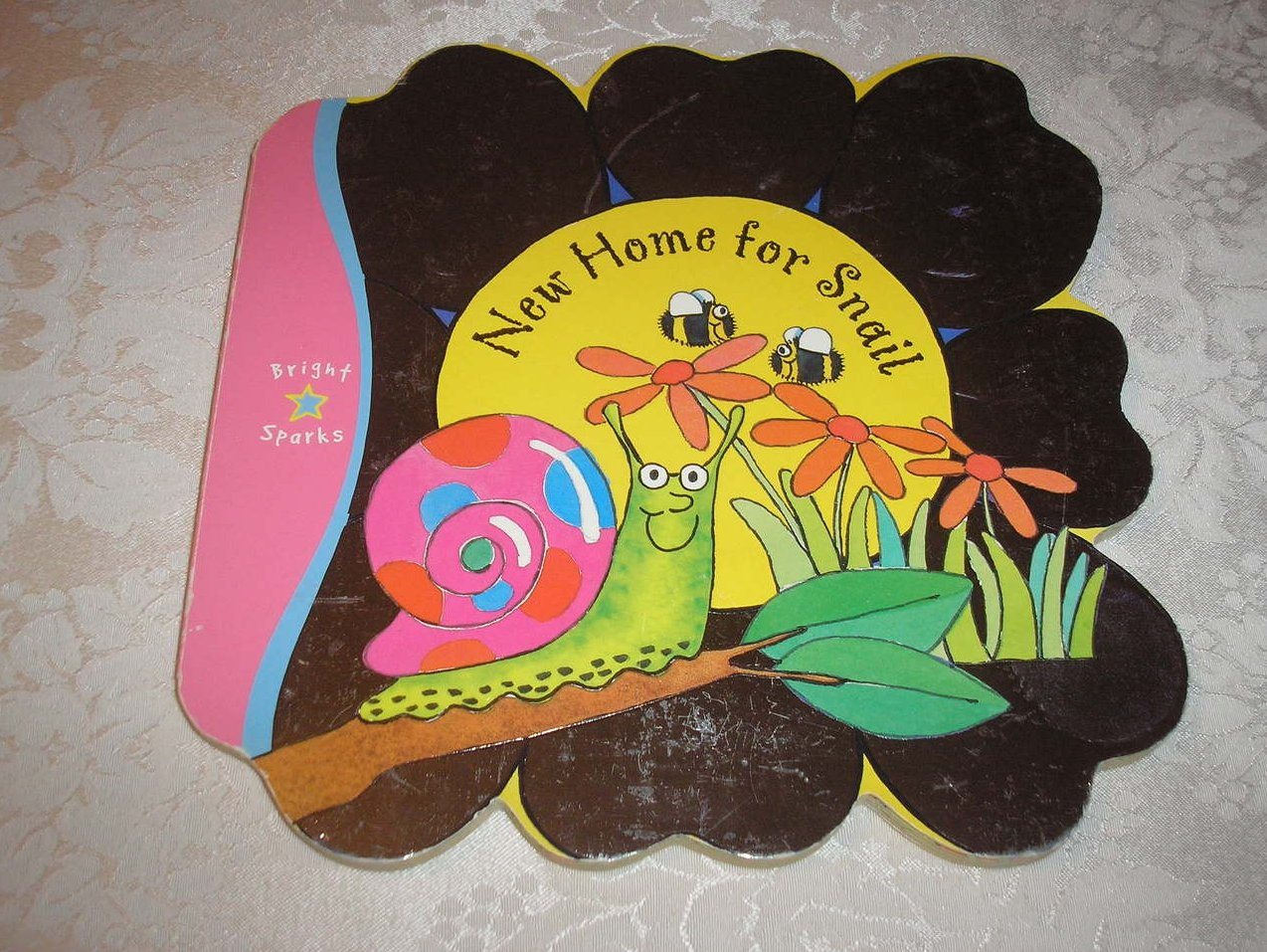 New Home for Snail Katie George good used shaped board book