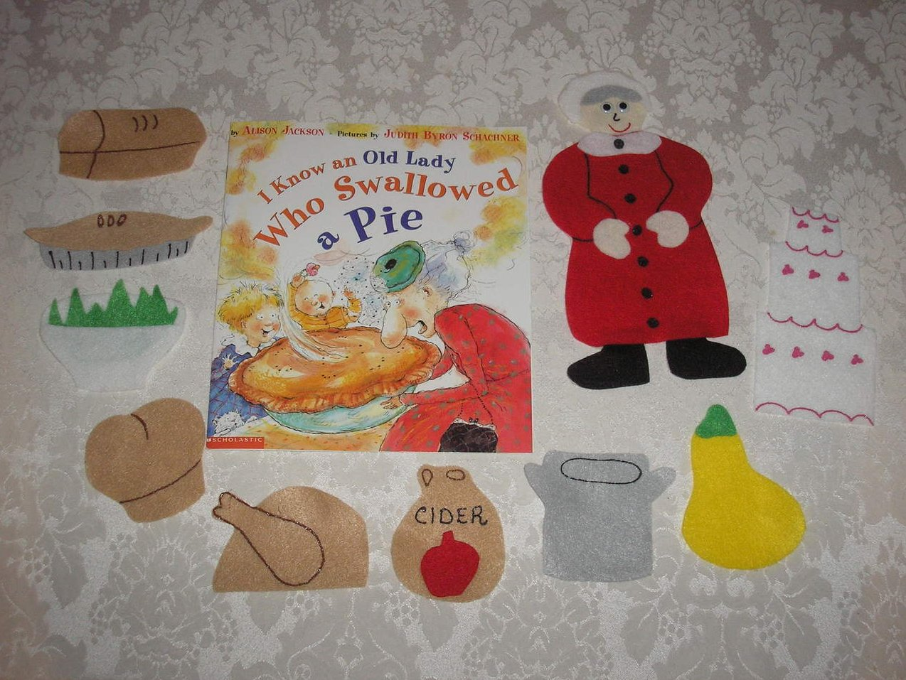 I Know An Old Lady Who Swallowed A Pie felt board set and brand new sc