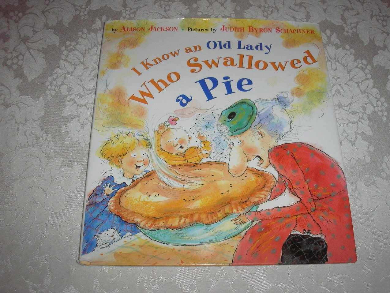 I Know an Old Lady Who Swallowed a Pie 1997 First Edition hardcover with dj