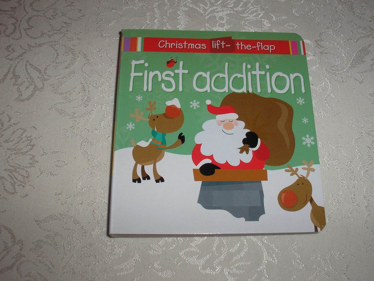 First Addition Christmas Lift-the-Flap brand new board book