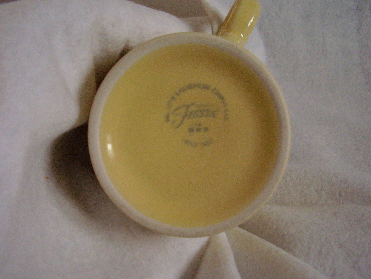 '.Fiesta yellow T & J mug.'