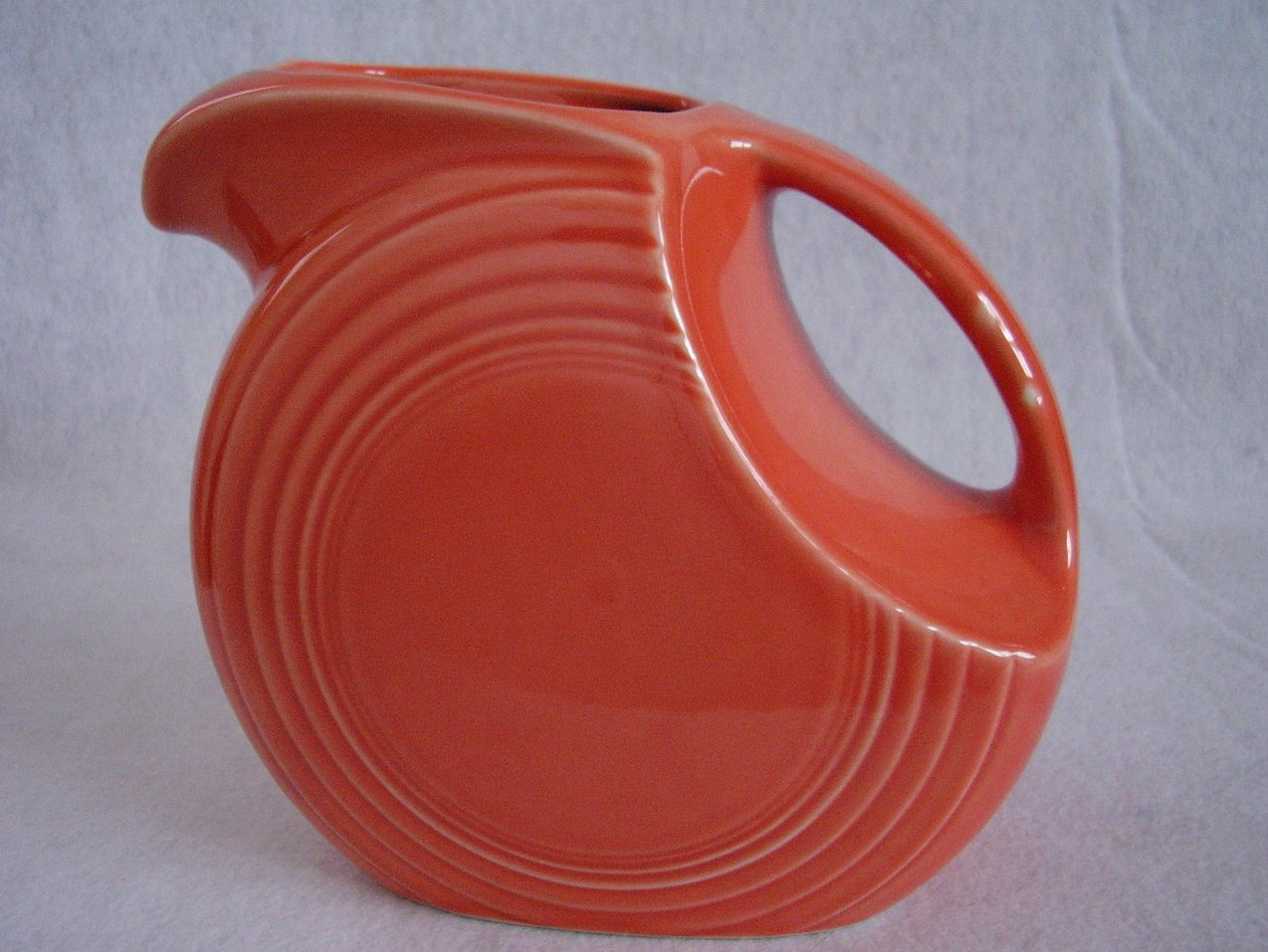 '.Fiesta Persimmon Disk Pitcher.'