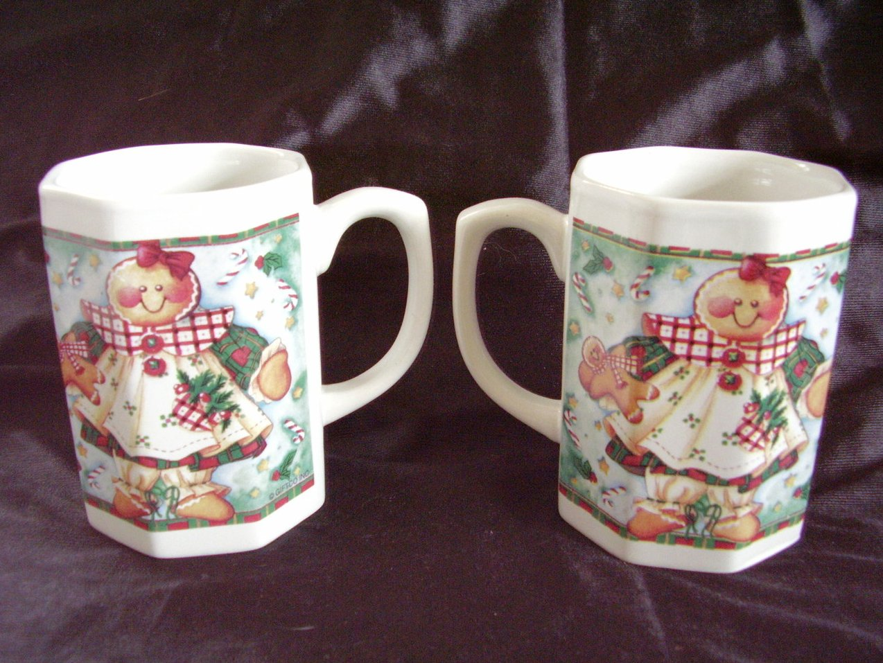 '.2 Ceramic Christmas mugs.'
