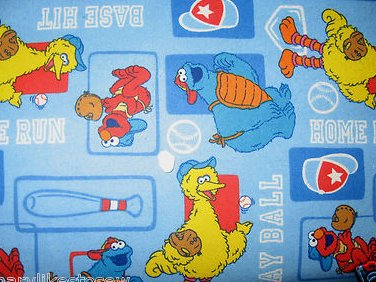 Image 0 of Sesame Street Big Bird Ernie Cookie monster baseball blue flannel by the yard