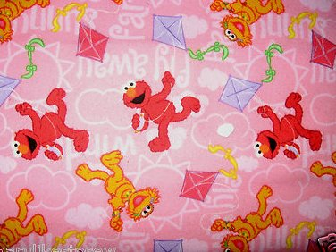 Sesame Street Zoe and Elmo flying kites pink Flannel Cotton Fabric by the yard