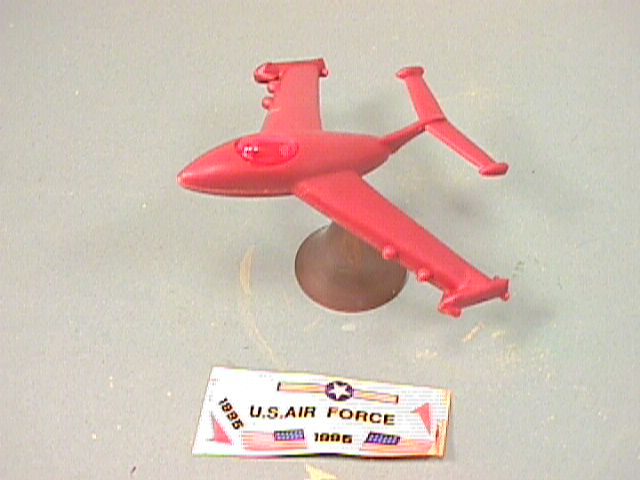 Balancing Red Plastic Jet Fighter Plane