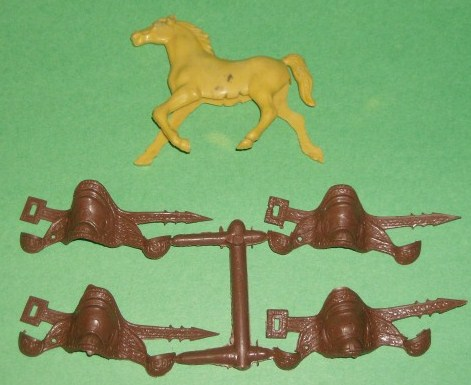 MPC Recast Set Of 12 Brown Plastic Western Saddles