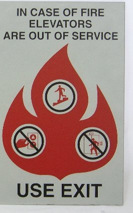 Image 0 of FSICF-58-A-SSP IN CASE OF FIRE SIGN 5X8 BRUSHED STAINLESS-LOOK PLASTIC