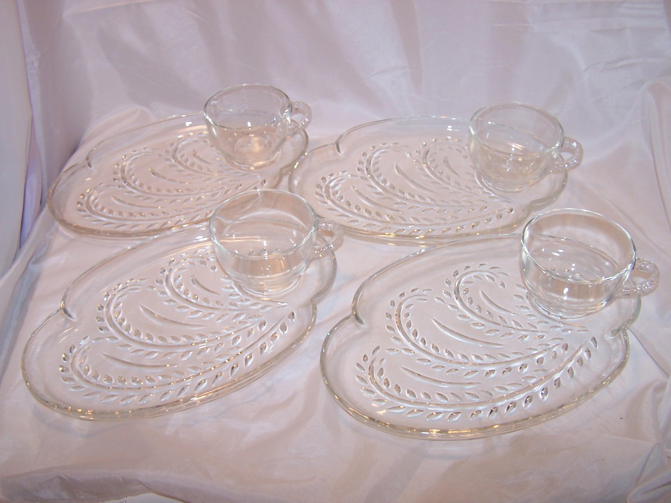 '.Four Plate, Four Teacup Set.'
