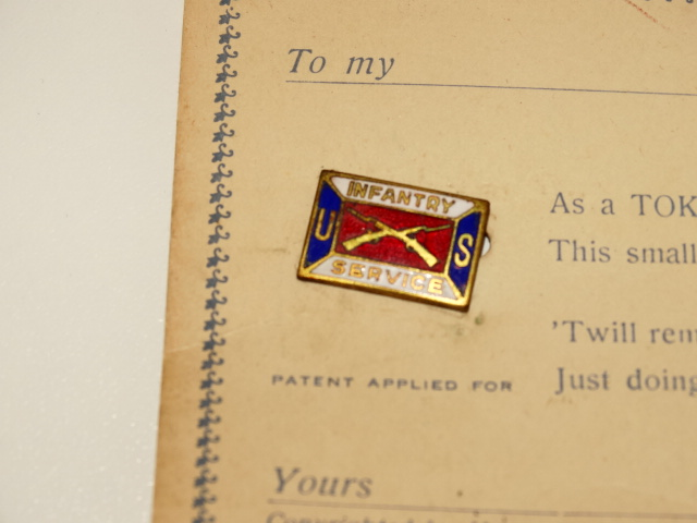 '.Crossed Rifles on WWI Pin.'