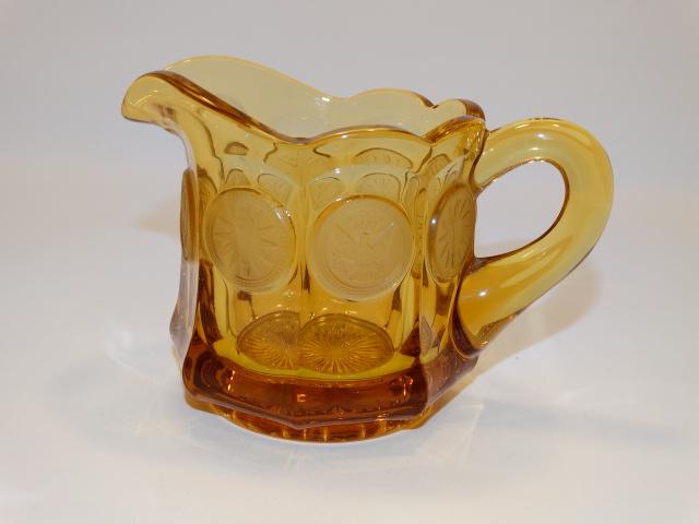 Coin Glass Amber Creamer Fostoria