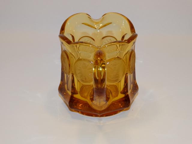Image 1 of Coin Glass Amber Creamer Fostoria