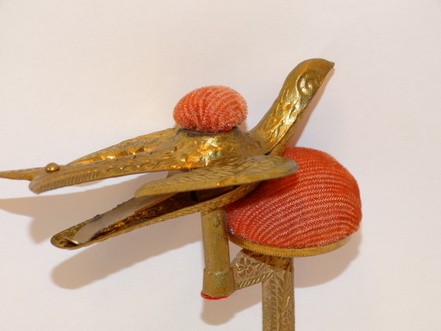 Image 1 of Sewing Bird Clamp Pincushion Bird Stamped Metal Vintage