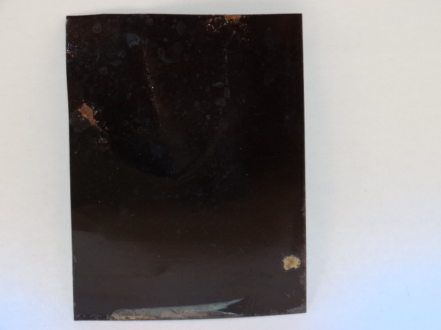 '.Enamelled Back of Tintype.'