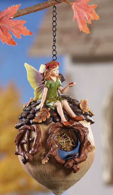 Green Fairy Sitting On Acorn Birdhouse