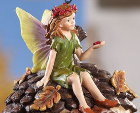 Image 1 of Green Fairy Sitting On Acorn Birdhouse