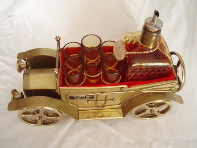 Image 1 of musical whiskey decanter and shot glasses  antique gold cadillac