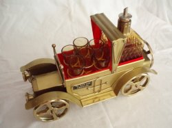 musical whiskey decanter and shot glasses  antique gold cadillac