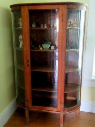 Antique Oak Curio Cabinet. Flat glass door, half round sides.