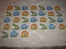 31 Laminated Dinosaur Calendar Pocket Chart Pieces in ABC pattern