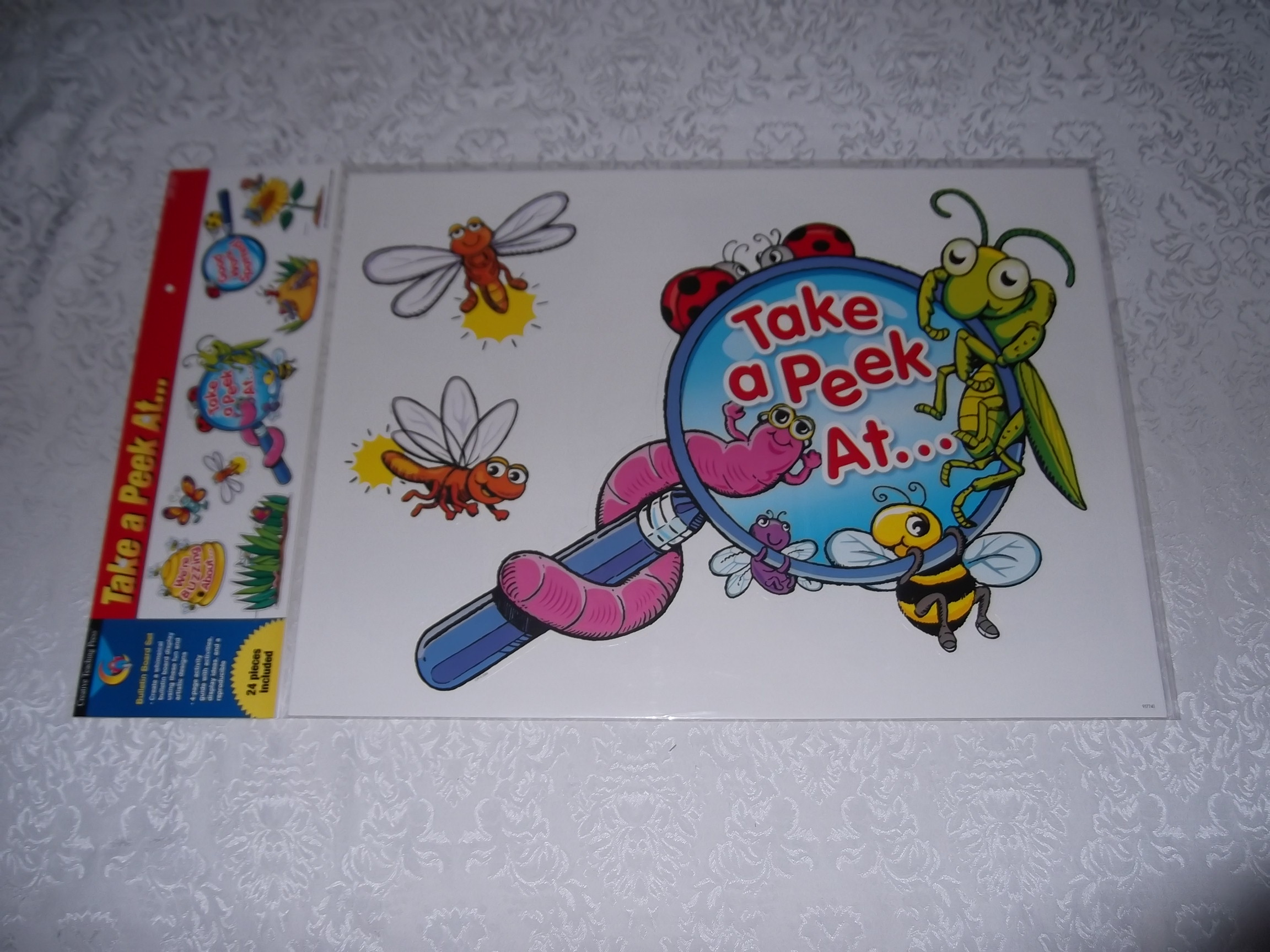 Bulletin Board Set with 24 Pieces Take a Peek At . . . Insects CTP 1774
