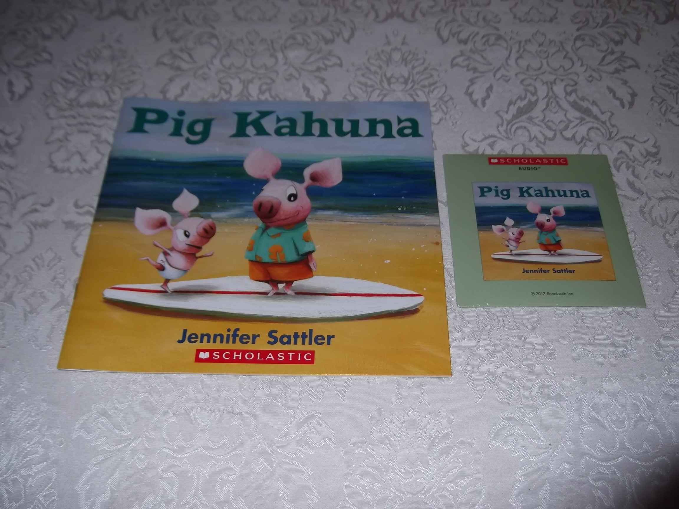 Pig Kahuna Jennifer Sattler Brand New Audio CD and Softcover