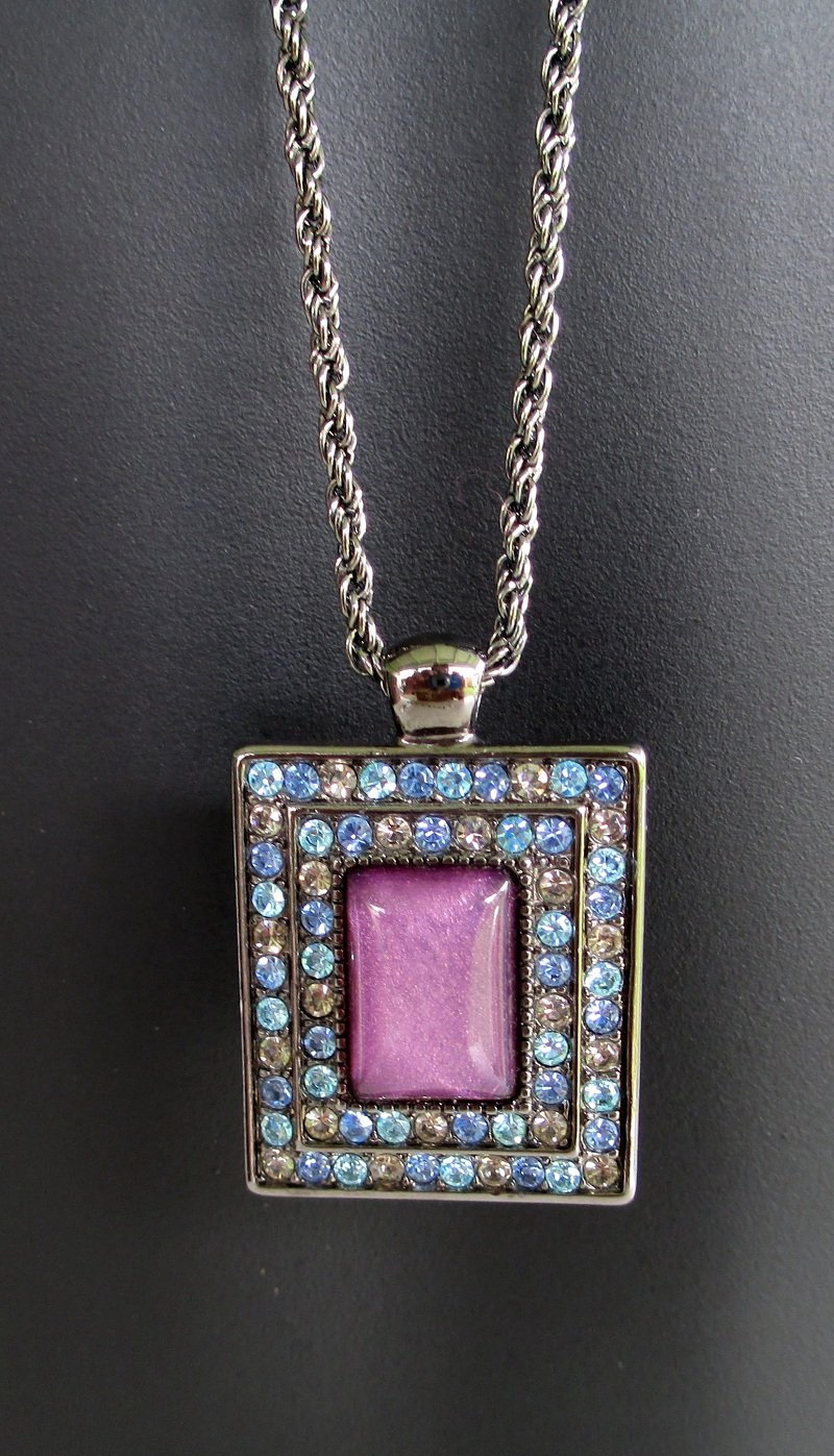 Purple, blue, and pink rhinestone pendant on a 32 inch black chain.