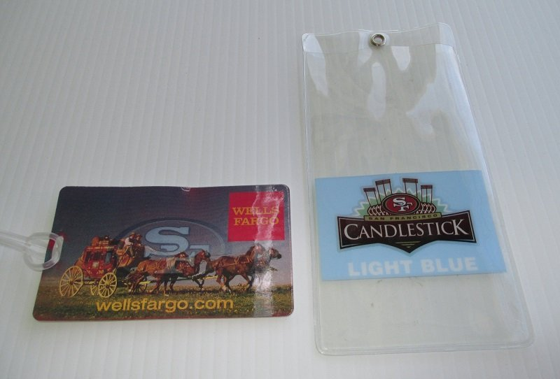 Souvenirs from Candlestick Park, home of the San Francisco SF 49ers, and Wells Fargo Bank. Luggage tag and ticket sleeve.
