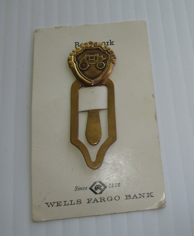 This Wells Fargo Bank stagecoach bookmark is from the 1970s but was never used. It's on its original card sleeve. Gold in color. 2 inches long.
