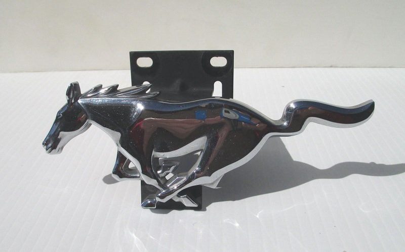 Ford approved Mustang Horse grille emblem with bracket. Chrome coloring, 6 inches long. Fits various 1994 � 2004 models. Mustangs Cobras Mach I.