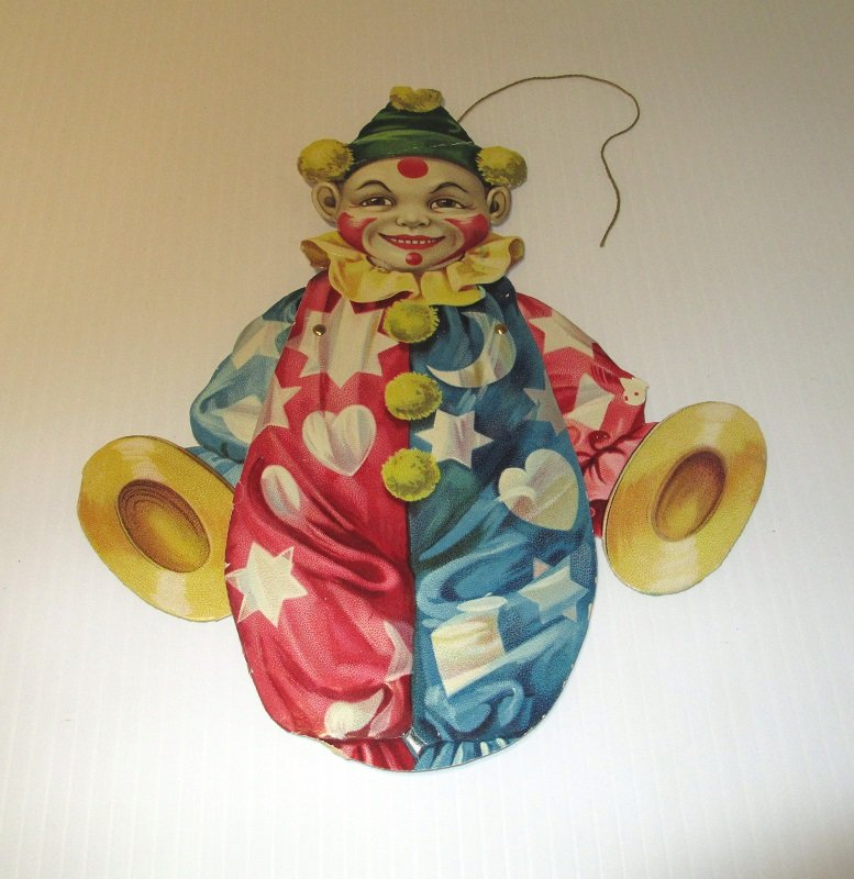 Antique Mechanical Clown Doll from the Raphael Tuck & Sons Company of London. Circa 1900 to 1910. Cardboard. Estate find.