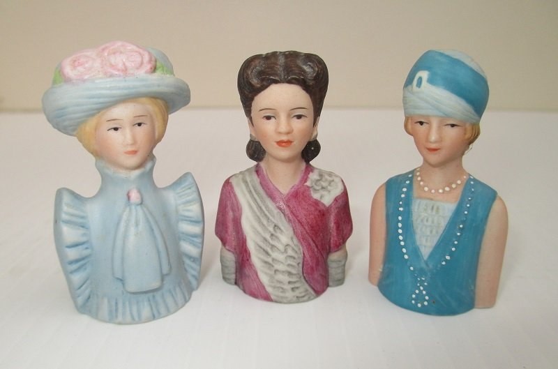 3 ladies from the Avon American Fashion Thimbles series. Each depicts a different era in time. 1890s to 1920s. 2 inches tall and marked Avon.