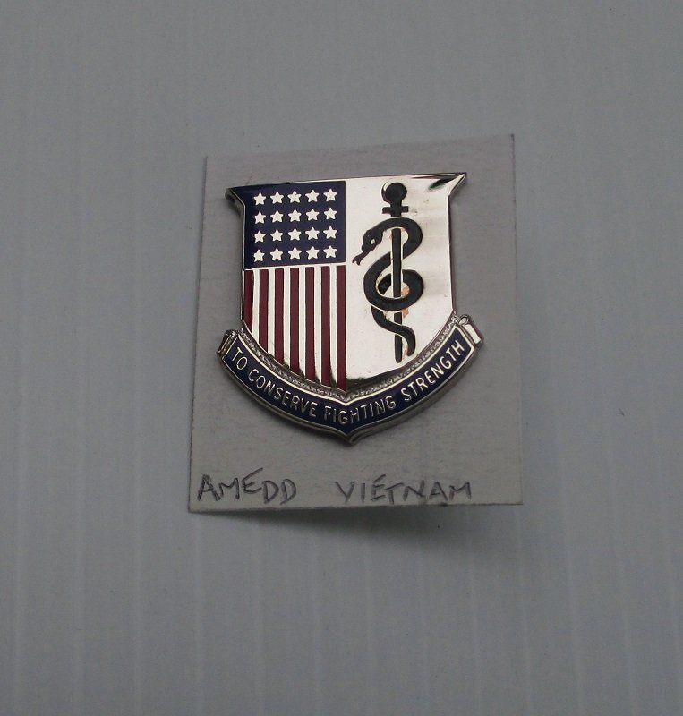 Insignia pin representing the Army Medical Corp.