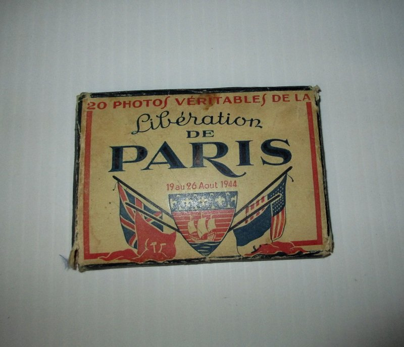 20 photo set of the Liberation of Paris in Patriotic envelope folder. Dated 1944. Original WWII period photos from estate sale of a participant.