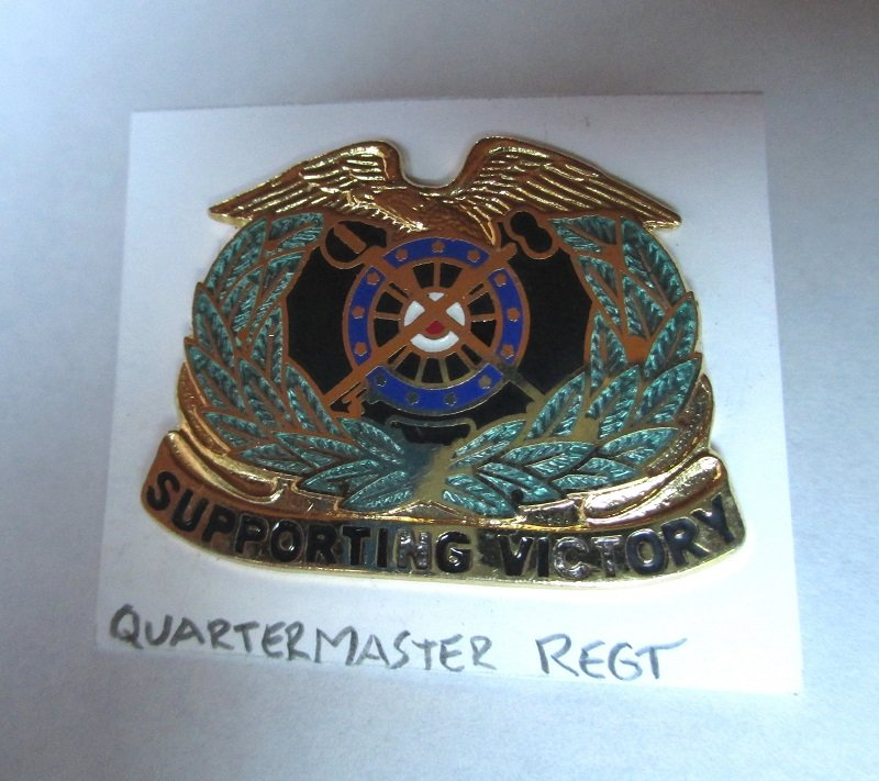 U.S. Army Quartermaster Regimental insignia metal pin. Supporting Victory. D-22. Worn on Army Uniforms and caps. Excellent condition. Estate find.