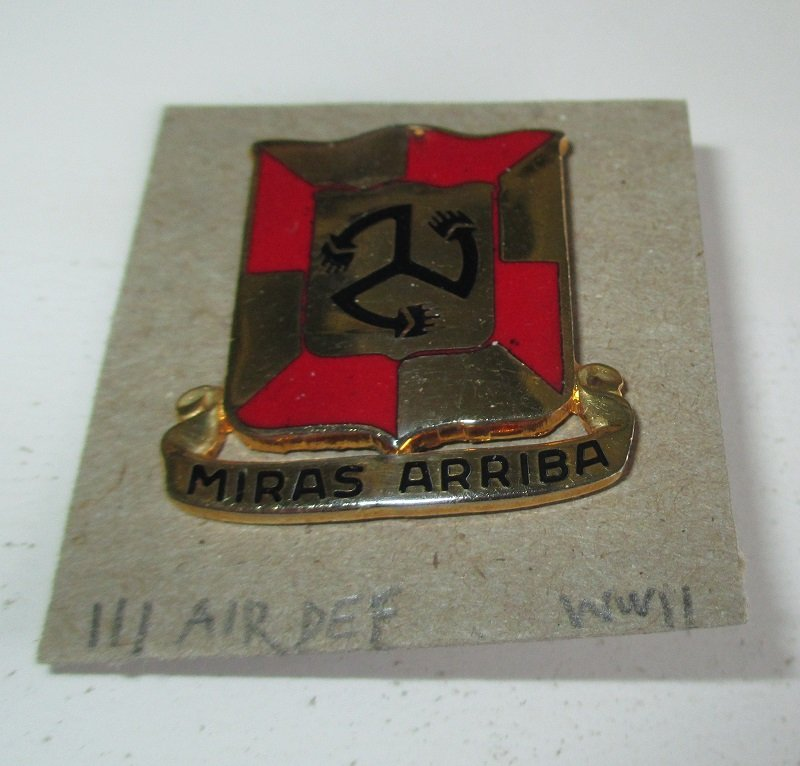 111th U.S. Army Air Defense Artillery Brigade WWII insignia metal pin. Miras Arriba. Worn on Army Uniforms and caps. Excellent condition. S-21