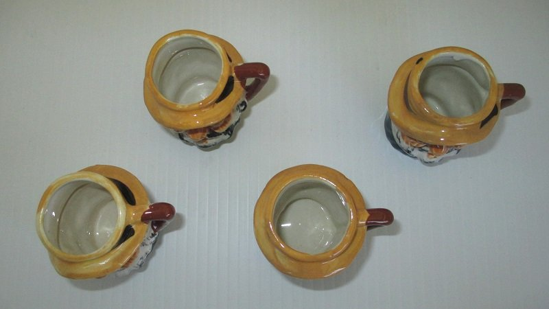 Set of 4 Old Man Toby Mugs. All marked Made in Occupied Japan. Date range would be 1945 to 1952. Measures 2.25 inches tall. All exactly alike.