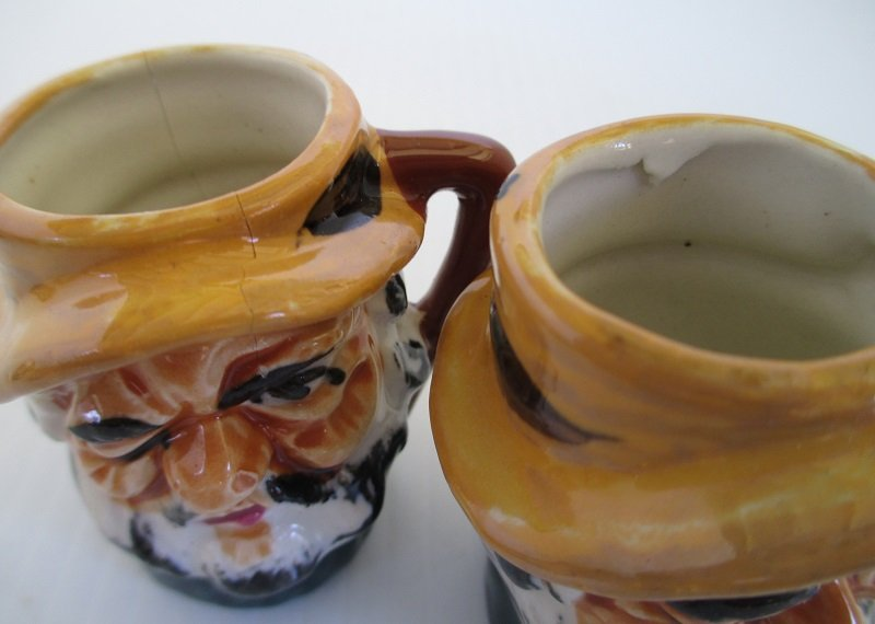 Crack and defect on 2 Toby Mugs. Marked Made in Occupied Japan. Date range of 1945 to 1952. Measures 2.25 inches tall. All exactly alike.