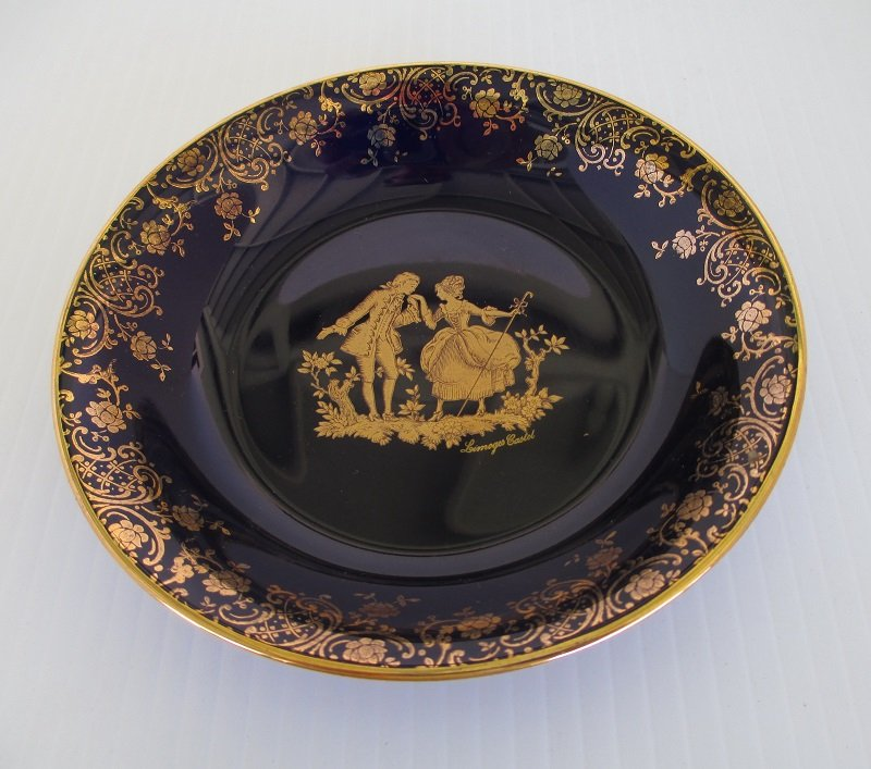 France made dish featuring a courting couple. Cobalt blue with 22k gold trim. 5.25 inches. Unknown age, estate find.