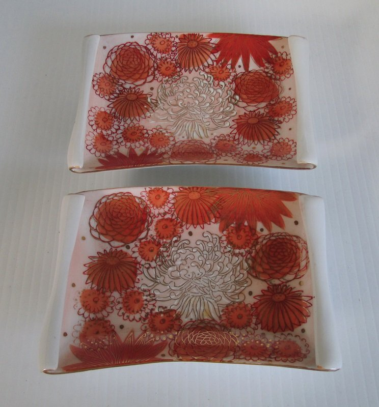 Mid century wall plates marked Fujita Kutani Japan. Mid century time frame. Porcelain and hand painted. Scroll design on ends with gold accents on edges.