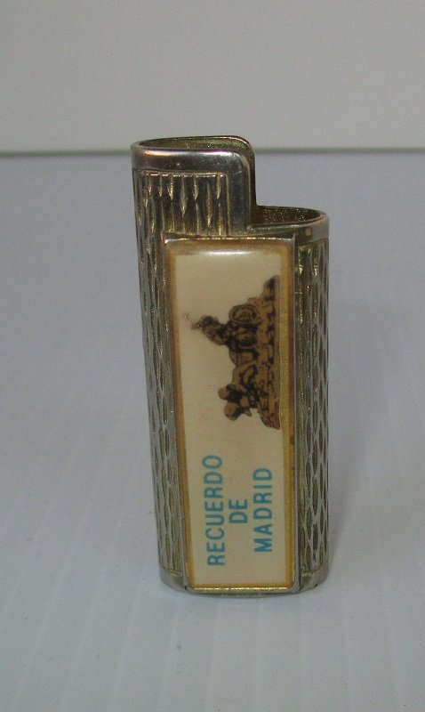 Vintage holder for the small Bic lighters. Recuerdo de Madrid (Souvenir of Madrid Spain). Possibly 1960s. Gold in color. Estate purchase.