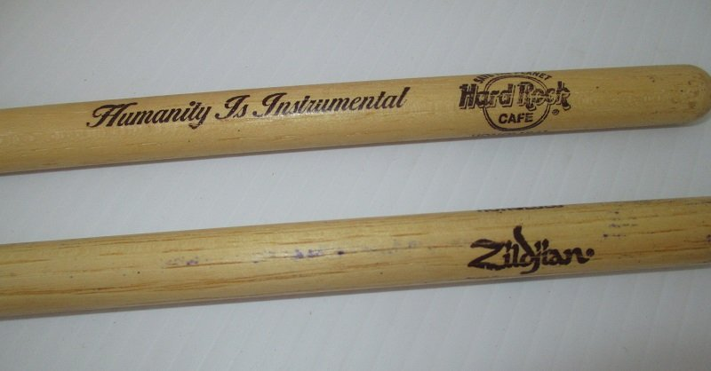 16.5 inch Hickory Wood drumsticks from the Hard Rock Cafe in Honolulu Hawaii. Marked Zildjian and Humanity is Instrumental. Nylon tips.