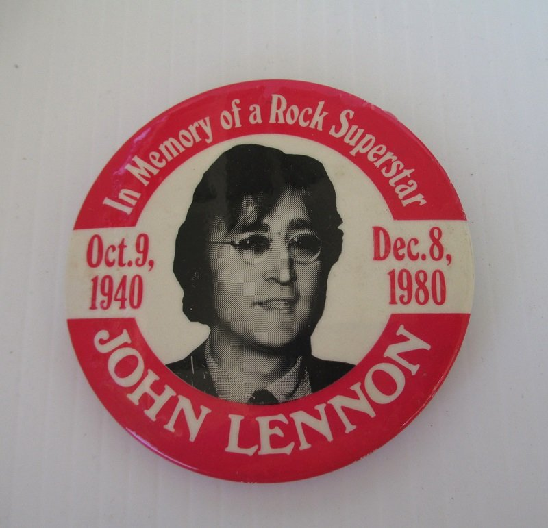Beatles Pinback memorial pin that states John Lennon, In Memory of a Rock Superstar, Oct 9. 1940 to Dec 8, 1980. Pin measures 3 inches across.