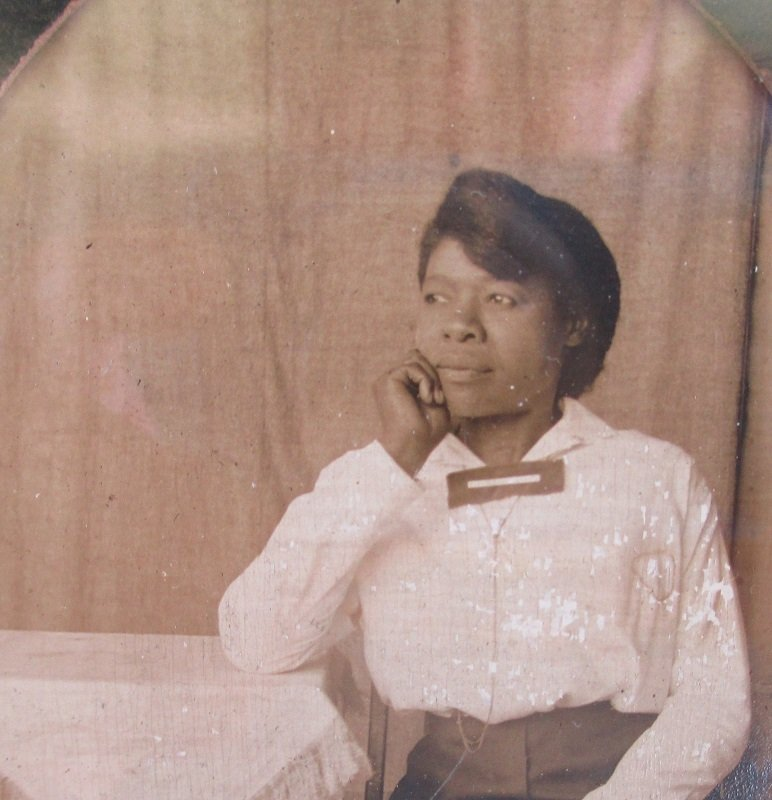 The note on the back of this African American Black woman's photo says this is Essie. She is giving this photo to her sister Annie. Its dated 1917.