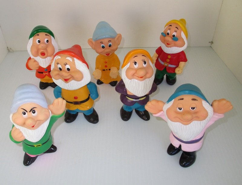 Front of complete set of the Seven Dwarfs from the Walt Disney movie Snow White. Flexible rubber squeaky toys. Estimated from 1960s.