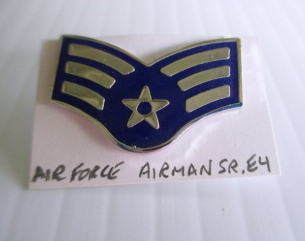 U.S. Air Force Enamel Rank pin. Designates Airman Sr. E4. Marked S21, G.I. Worn on Air Force Uniforms. Excellent condition. Estate find.