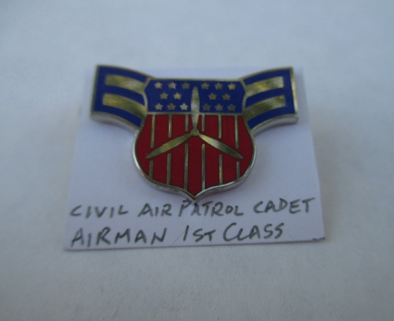 This rank pin is the designation for a Civil Air Patrol Cadet Airman 1st Class. There are 4 available. Unknown age, estate find.